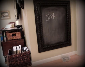 A home-made chalkboard creates a mini-play space.