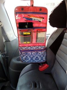 Travel / vacation tip: Use a hanging toiletry bag to keep markers and small games within reach during road trips @ jaxinthebox.com
